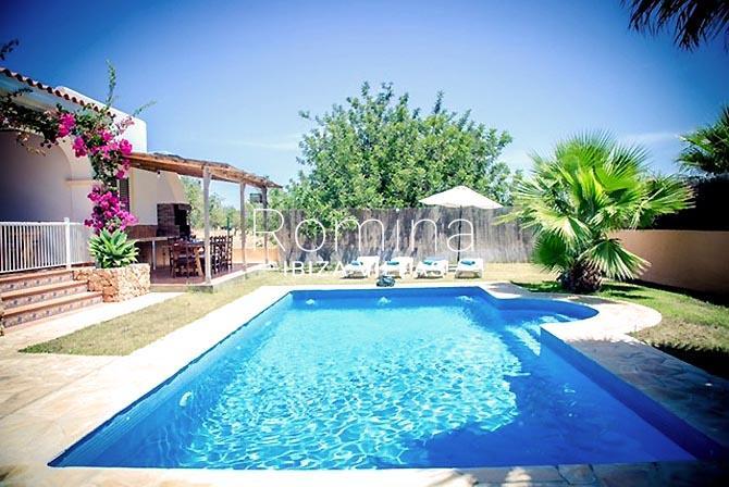 villa portico ibiza-2pool lawn terrace dining area