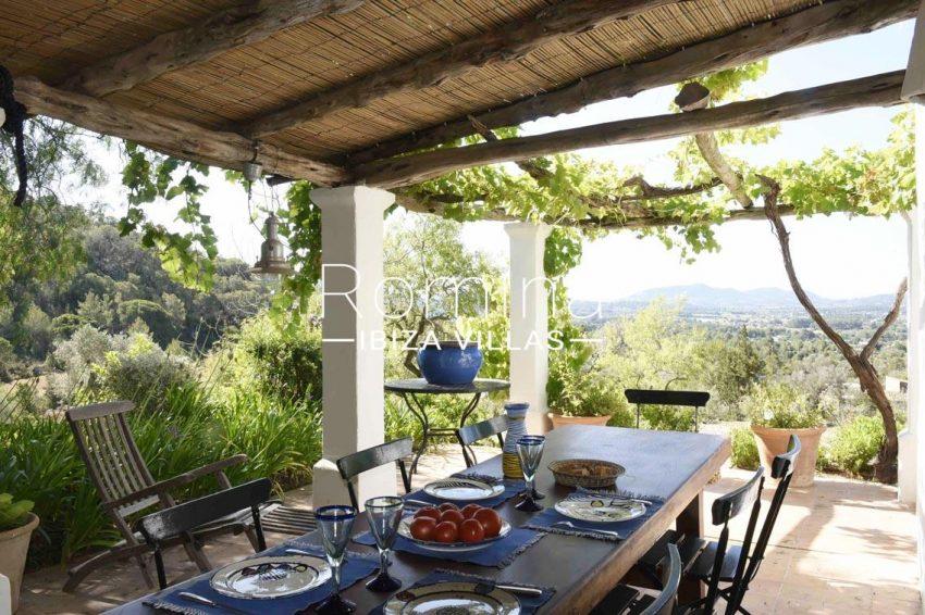 finca bridie ibiza-2pergola terrace dining area view hills