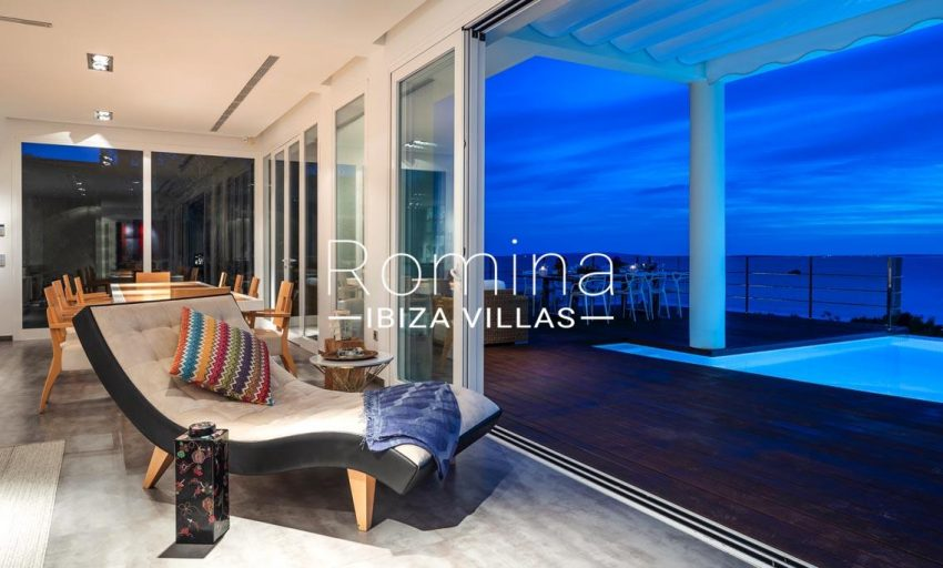 villa sedna ibiza-3living dining room sea view by night