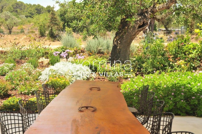 can puxet ibiza-2covered terrace dining table garden with flowers