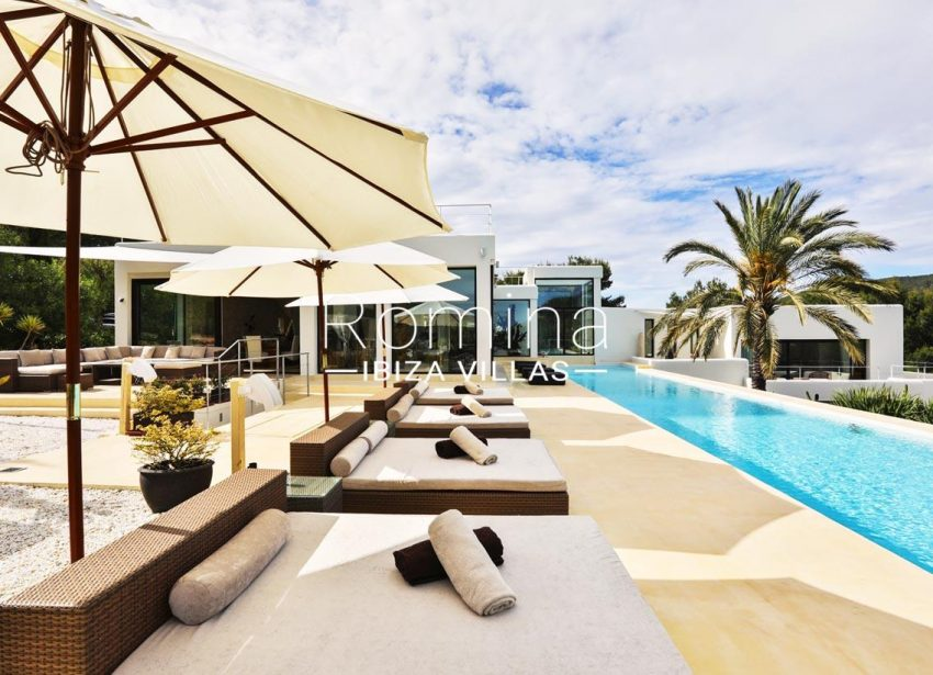 villa blue bay ibiza-2pool terrace deck chairs