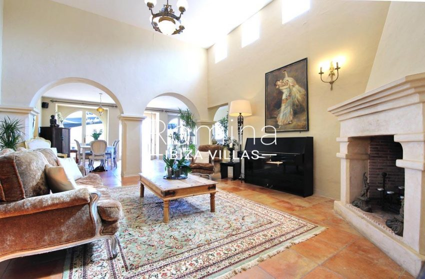 villa shanti ibiza-3living room fireplace dining room