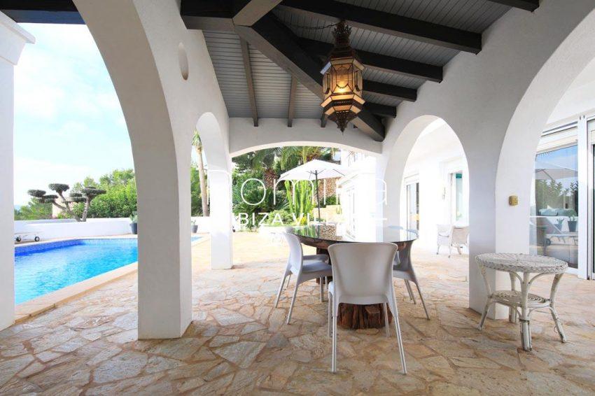 villa hibiscus ibiza-2pool porch dining area
