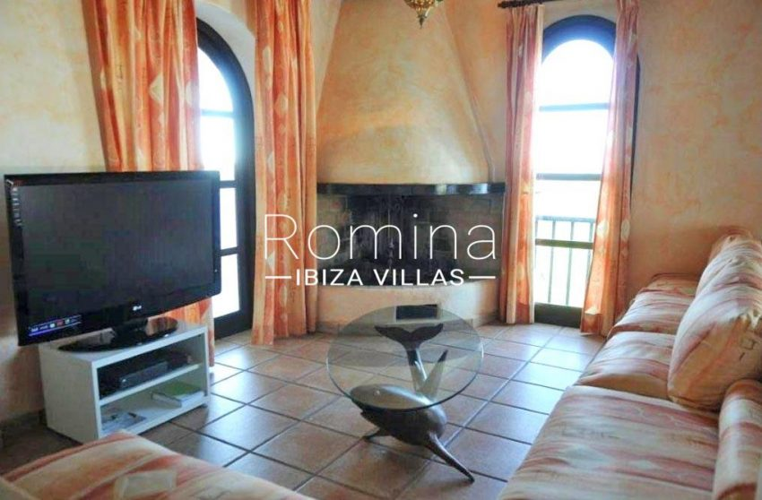 romina-ibiza-villas-casa-kala-rv-736-81-3sitting room fireplace