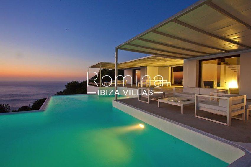 romina-ibiza-villas-rv-864-04-villa-neptunia-1pool facade sea view sunset