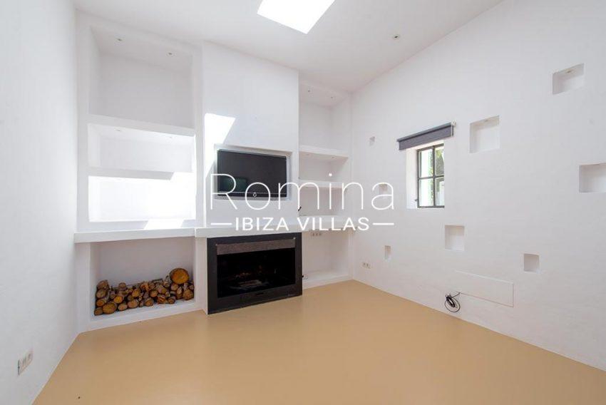 romina-ibiza-villas-rv-916-33-villa-es-paradis-3living room fireplace guest house